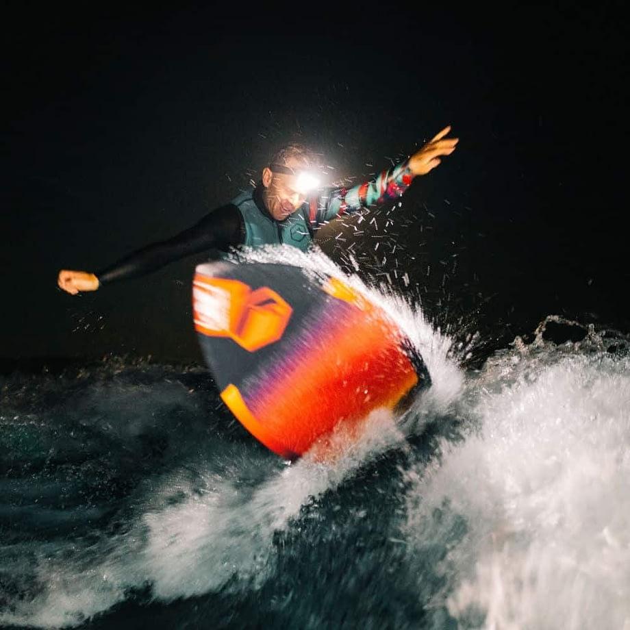 Man wakesurfing wearing Broadview Headlamp