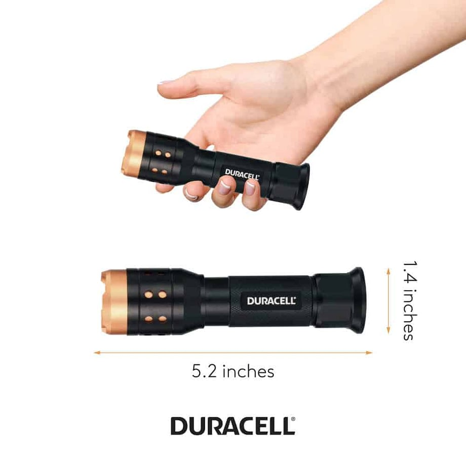 Person holding flashlight to show size