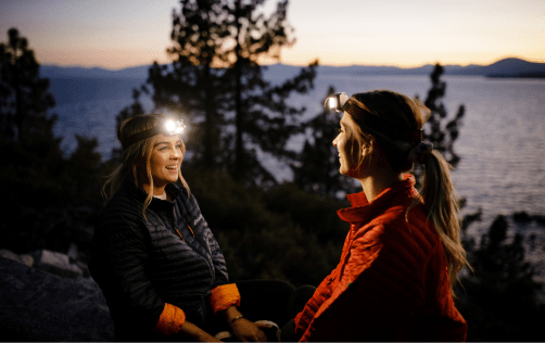 women exploring nature with headlamps
