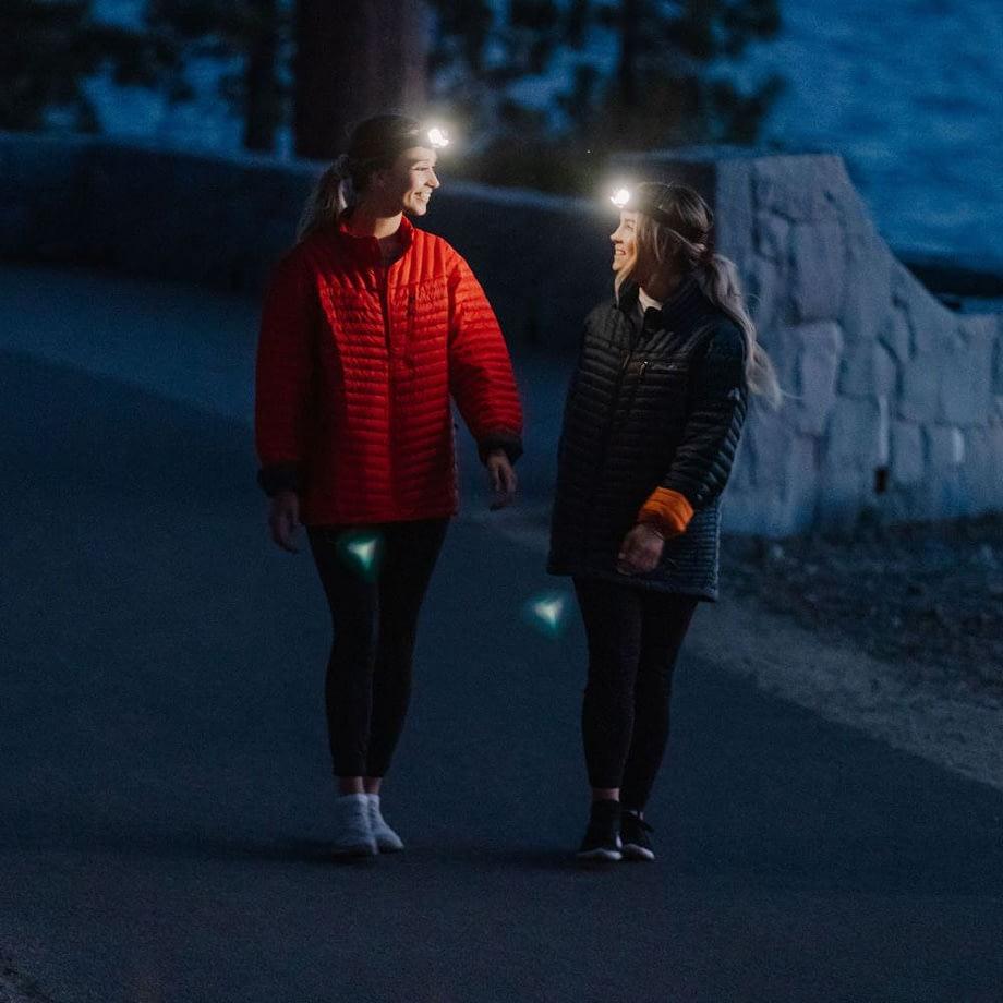 people walking at night wearing broadview headlamps