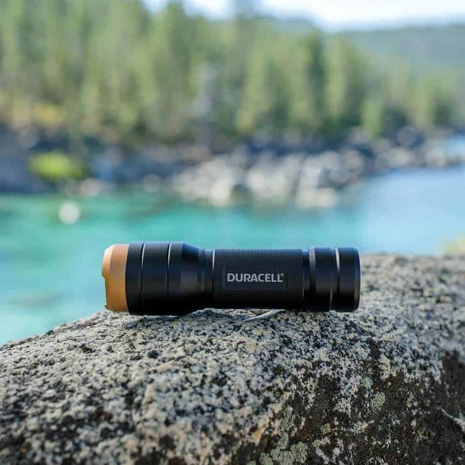 250 Lumen Aluminum Flashlight on a rock
